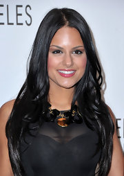 Pia played up her sheer neckline with a gold and black statement necklace.