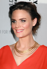 Actress Emily Deschanel put a modern twist on her elegant chignon by twisting strands and pinning them into place.