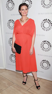 Emily was glowing at the 'Bones' media event in a loose salmon cocktail dress.