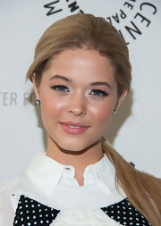 Sasha Pieterse chose a sleek and straight ponytail to pull back her blonde locks.