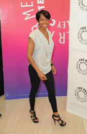 Regina King was casual yet chic at the Evening with Southland event in a gray cowl-neck top and black leggings.