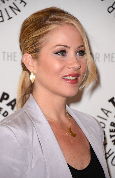 Christina Applegate attended an evening of 'Up All Night' wearing her glossy locks in a sleek wrapped ponytail with long side-swept bangs.