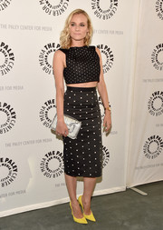 Diane Kruger was in the mood for mixing patterns, pairing her outfit with a black-and-white striped clutch by Pierre Hardy.