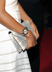 Kerry Washington attended the She's Making Media event carrying an ultra-elegant snakeskin envelope clutch.