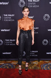 Camren Bicondova contrasted her demure top with edgy paper-bag leather pants.