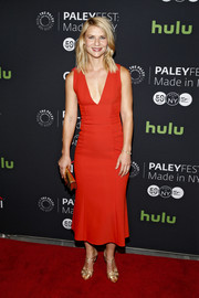 Claire Danes polished off her sleek ensemble with gold T-strap sandals by Francesco Russo.