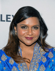 Mindy Kaling styled her hair with a side part and gentle waves for PaleyFest New York 2015.