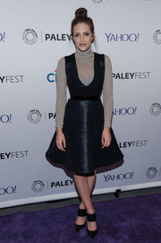 Carly Chaikin completed her outfit with a pair of black broad-strap pumps.