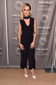 Taryn Manning chose a cropped pinstriped jumpsuit for the PaleyLive LA 'Orange is the New Black' event.