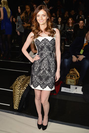 Lydia Hearst was sexy yet classy in a black-and-white lace-embellished cocktail dress during the Pamella Roland fashion show.