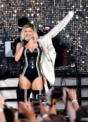 Fergie looked va-va-voom in a black-and-white latex bodysuit while performing at the Pandora Summer Crush.