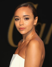 Ashley Madekwe kept it simple with this slicked-down ponytail at the Panthere De Cartier party.