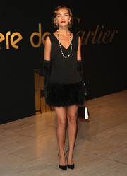 Arizona Muse channeled the roaring '20s with this fur-hem LBD at the Panthere De Cartier party.