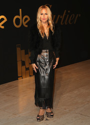 Rachel Zoe teamed a fringed leather skirt with a long-sleeve blouse and a fur vest for the Panthere De Cartier party.