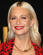 Poppy Delevingne swiped on some red lipstick to match her outfit.