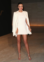 Miranda Kerr styled her look with the celeb-favorite Tamara Mellon Frontline sandals, in silver.
