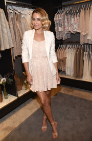 Lauren Conrad finished off her dress with a stylish white blazer from her own line.