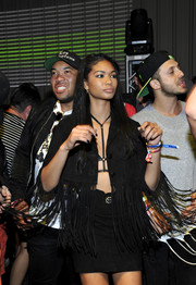 Chanel Iman worked some major fringe in a funky black skirt suit during the Paper Magazine Neon Carnival.
