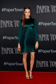 Cara Delevingne was modern and stylish at the 'Paper Towns' Australian premiere in a long-sleeve emerald-green dress by Dion Lee, featuring a net overlay and a cutout at the back.