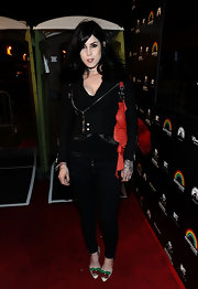 Kat Von D added a playful finish to her all black look with pointy white pumps adorned with cherries.