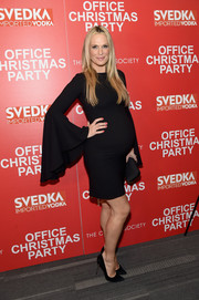 Molly Sims attended the screening of 'Office Christmas Party' wearing a skintight black maternity dress with super-flared sleeves.