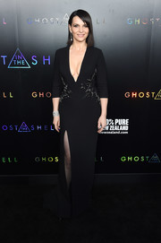 Juliette Binoche was all about understated elegance in a curve-hugging black DAN Couture gown with a deep-V neckline, an embellished waist, and a thigh-high slit at the premiere of 'Ghost in the Shell.'