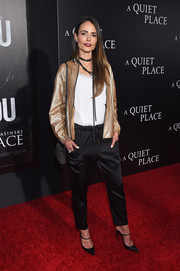 Jordana Brewster was sporty-chic in a gold bomber jacket by Brunello Cucinelli at the New York premiere of 'A Quiet Place.'