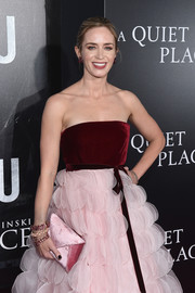 Emily Blunt attended the New York premiere of 'A Quiet Place' carrying a pink velvet envelope clutch by Tyler Ellis.