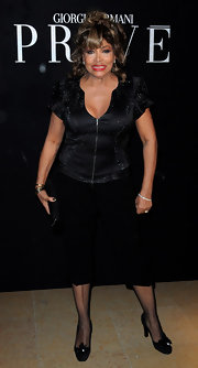 Tina Turner went for casual sophistication in a sparkly black zip-up top.