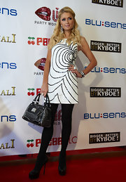 Paris Hilton topped off her chic black and white beaded mini dress with classic black platform pumps.