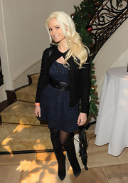 Holly Madison layered a black cardigan over her flirty blue leopard print frock.