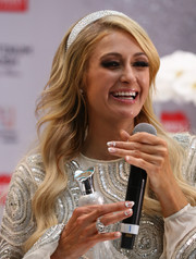 Paris Hilton showed off a classic French mani, made more festive with the addition of some glitter polish, at the Platinum Rush fragrance launch.
