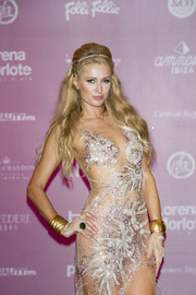 Paris Hilton gleamed with a pair of gold cuffs teamed with a beaded dress at the 'Foam & Diamonds' event in Ibiza.