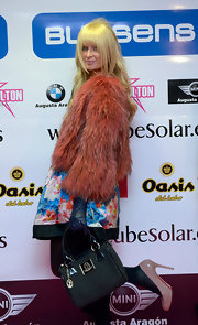 Paris Hilton partied in Zaragoza, Spain with a  bright fur coat paired with classic taupe patent leather pumps.