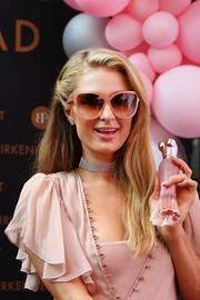 Paris Hilton sported a half-pinned, subtly wavy hairstyle at the launch of her new fragrance in Sydney.