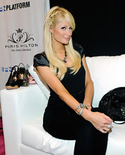 Paris Hilton showed off her sparkling cuff bracelet while hitting the unveiling of her shoe collection.
