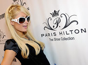 The heiress modeled a pair of oversized white sunglasses while unveiline her Spring 2011 shoe collection.
