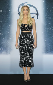Jennifer Lawrence flashed her cleavage and abs in a black-and-white polka-dot crop-top by Dolce & Gabbana at the 'Passengers' photocall in Berlin.
