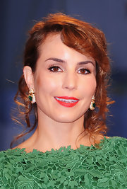 Noomi Rapace's bright red lipstick looked striking against her green dress when she attended the 'Passion' premiere.