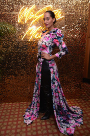 Tracee Ellis Ross teamed a floor-sweeping floral dress by Ronald van der Kemp Couture with a pair of black leather boots for the Pat McGrath Unlimited Collection launch.