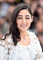 Golshifteh Farahani sported spiral curls swept to the side when she attended the Cannes photocall for 'Paterson.'