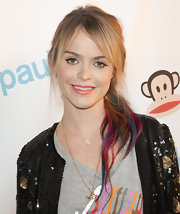 Taryn Manning rocked a rainbow-hued head of hair and kept her makeup simple at Fashion's Night Out in New York. To try her coral-lipped look at home, we recommend NARS Cream Lipstick in Niagra.