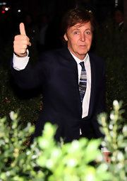 Paul McCartney wore a blue striped tie with his matching blue suit.