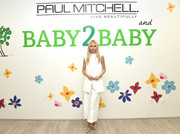 Rachel Zoe attended the Baby2Baby Partner Appreciation Day wearing a loose, sleeveless white pantsuit.