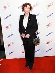 Susan Sarandon traded in a feminine frock for this classic pantsuit with satin lapels for her red carpet look.