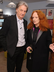 Grace Coddington attended the Paul Smith New York 25th Anniversary Celebration wearing a black duster coat with a leather collar.