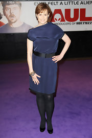 Sigourney donned a silky navy cocktail dress with a black belt and opaque tights for the 'Paul' premiere.