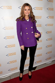 Maria Menounos injected color into her winter wear with a purple pea coat with gold buttons.