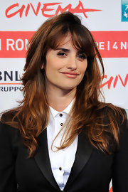 Penelope Cruz wore a black suit with a masculine edge while she kept her luxurious locks looking feminine with long, soft waves at the 6th International Rome Film Festival.