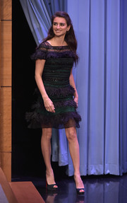 Penelope Cruz was flapper-chic in a feather-embellished cocktail dress by Carolina Herrera while visiting 'Jimmy Fallon.'
